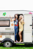 Happy friends are having a good time together in camper trailer. Royalty Free Stock Photography