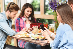 Happy friends having lunch in cafe Royalty Free Stock Images