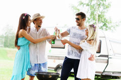 Happy friends having a party outdoors. Royalty Free Stock Image