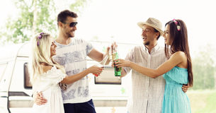 Happy friends having a party outdoors. Holiday, party, free time Stock Images