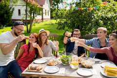 Happy friends having party at summer garden Royalty Free Stock Image