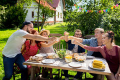 Happy friends having party at summer garden Stock Photo