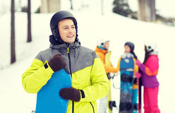 Happy friends in helmets with snowboards Stock Images