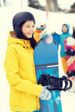 Happy friends in helmets with snowboards Royalty Free Stock Photo