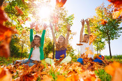Happy friends hold arms straight in the forest Royalty Free Stock Photography