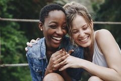 Happy friends holding each other royalty free stock image