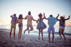 Happy friends holding hands and jumping Royalty Free Stock Photography