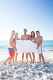 Happy friends holding poster Stock Image