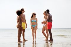 Happy friends hugging on summer beach stock photography