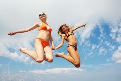 Happy friends jumping Royalty Free Stock Image