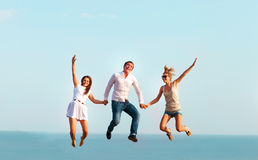 Happy friends jumping on the beach Stock Photography