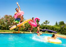 Free Happy Friends Jumping In Pool On The Vacations Royalty Free Stock Images - 132344429