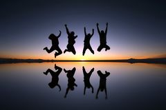 Happy friends jumping outdoor Stock Photography
