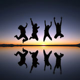 Happy friends jumping outdoor Stock Photo
