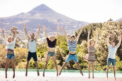 Happy friends jumping Stock Photos