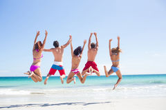 Happy friends jumping together Stock Photography