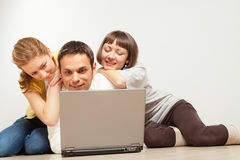 Happy friends with laptop computer Royalty Free Stock Image