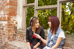 happy friends listen to music Stock Image