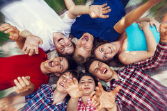 Happy friends lying together in circle Stock Images