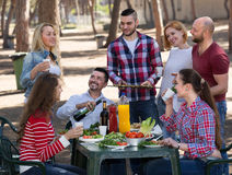 Happy friends making grill Stock Photos
