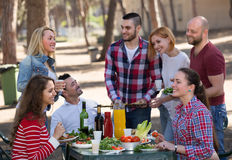 Happy friends making grill Royalty Free Stock Images