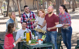 Happy friends making grill Stock Photography