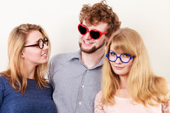 Happy friends man and women in glasses. stock photos