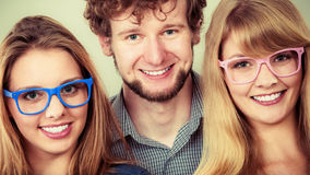 Happy friends man and women in glasses. Stock Photo