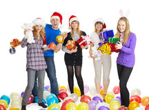 Happy friends with New Year's gifts on white Royalty Free Stock Photos