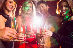 Happy friends on a night out together Stock Image