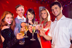 Happy friends on a night out together Stock Images