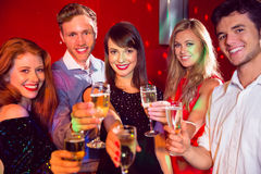 Happy friends on a night out together Royalty Free Stock Photo