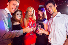 Happy friends on a night out together Stock Photos