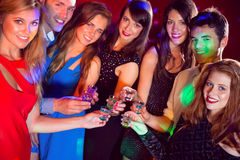 Happy friends on a night out together Royalty Free Stock Images
