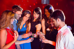 Happy friends on a night out together Royalty Free Stock Photography