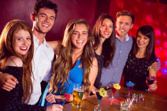 Happy friends on a night out together Royalty Free Stock Image