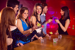 Happy friends on a night out together Stock Photography