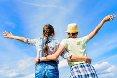 Happy friends with open arms under blue sky Royalty Free Stock Images
