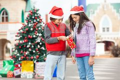Happy Friends Opening Gift Stock Photography