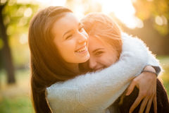 Happy friends outdoor. Two friends -  teenage girls hugging  outdoor in autumn at sunset Royalty Free Stock Photography