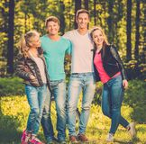 Happy friends outdoors. Group of happy friends outdoors on sunny day stock photo