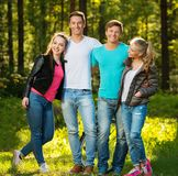 Happy friends outdoors. Group of happy friends outdoors on sunny day royalty free stock image
