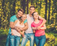 Happy friends outdoors. Group of happy friends outdoors on sunny day stock images