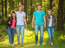 Happy friends outdoors. Group of happy friends outdoors on sunny day royalty free stock photos