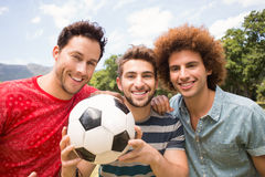 Happy friends in the park with football Stock Photo