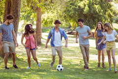 Happy friends in the park with football Royalty Free Stock Images