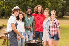 Happy friends in the park having barbecue Royalty Free Stock Image