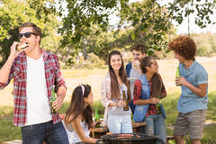 Happy friends in the park having barbecue Stock Photo