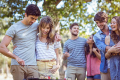 Happy friends in the park having barbecue Royalty Free Stock Photos