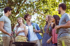 Happy friends in the park having barbecue Stock Images